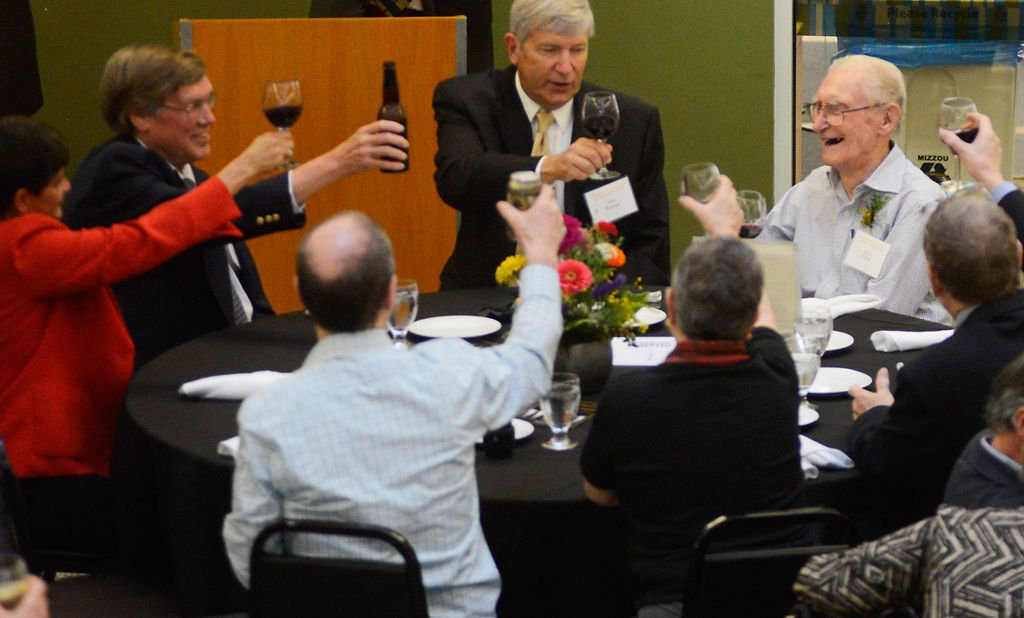 A toast is raised in honor of Boyd O'Dell