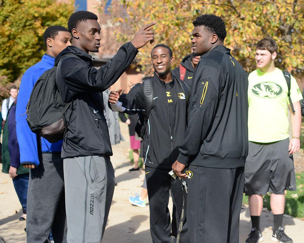 Football players talk after attending walkout
