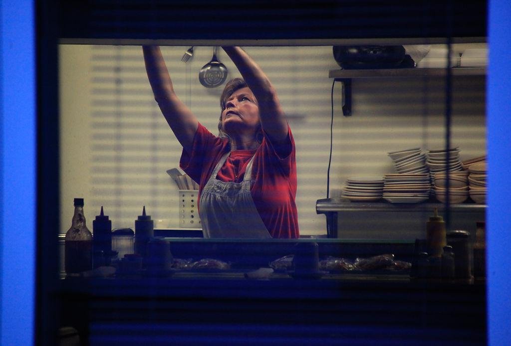 Lucy Reddick prepares to serve breakfast