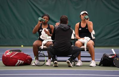 Serena Nash, left, and Lisa Fukutoku drink water during a break (copy)