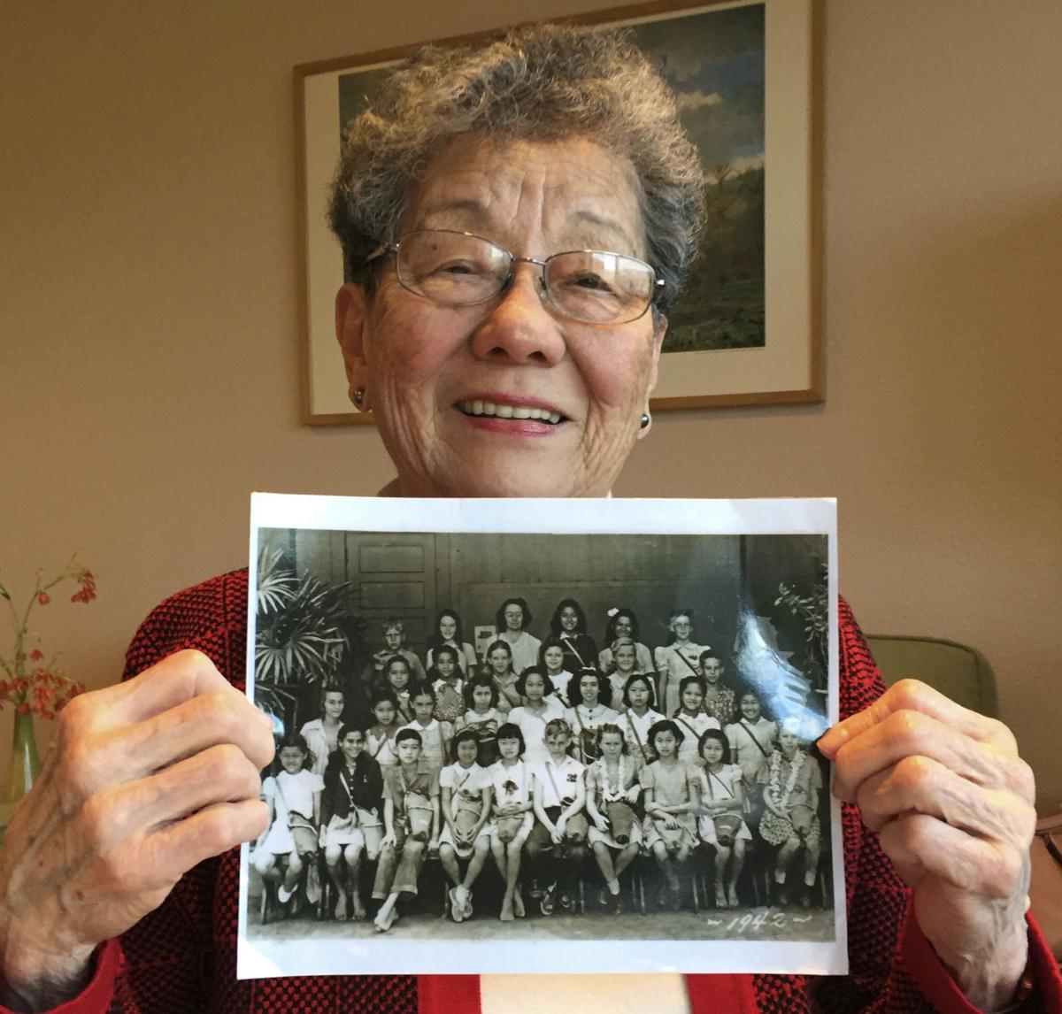 Seto holds a photo from 1942
