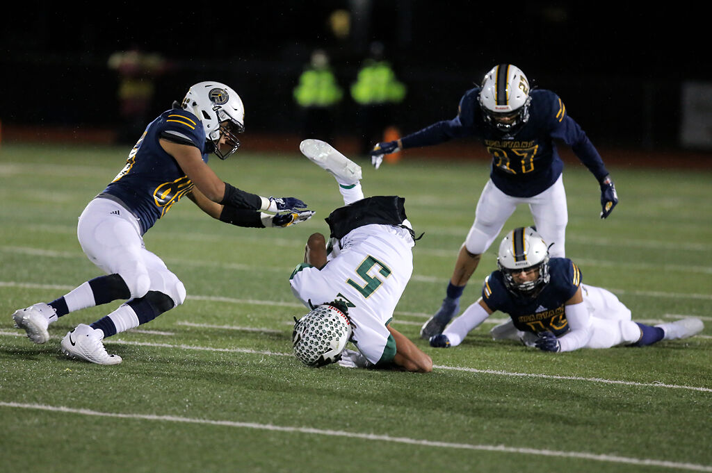 Fort Zumwalt North junior Jalen Lee flips over after being tackled by Battle junior Jaylen Broadus