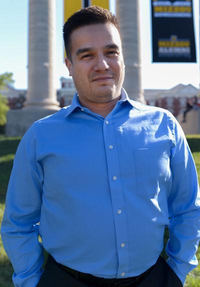 Francisco Sanchez stands for a portrait