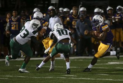 Hickman sophomore Keith Kelley runs with the ball