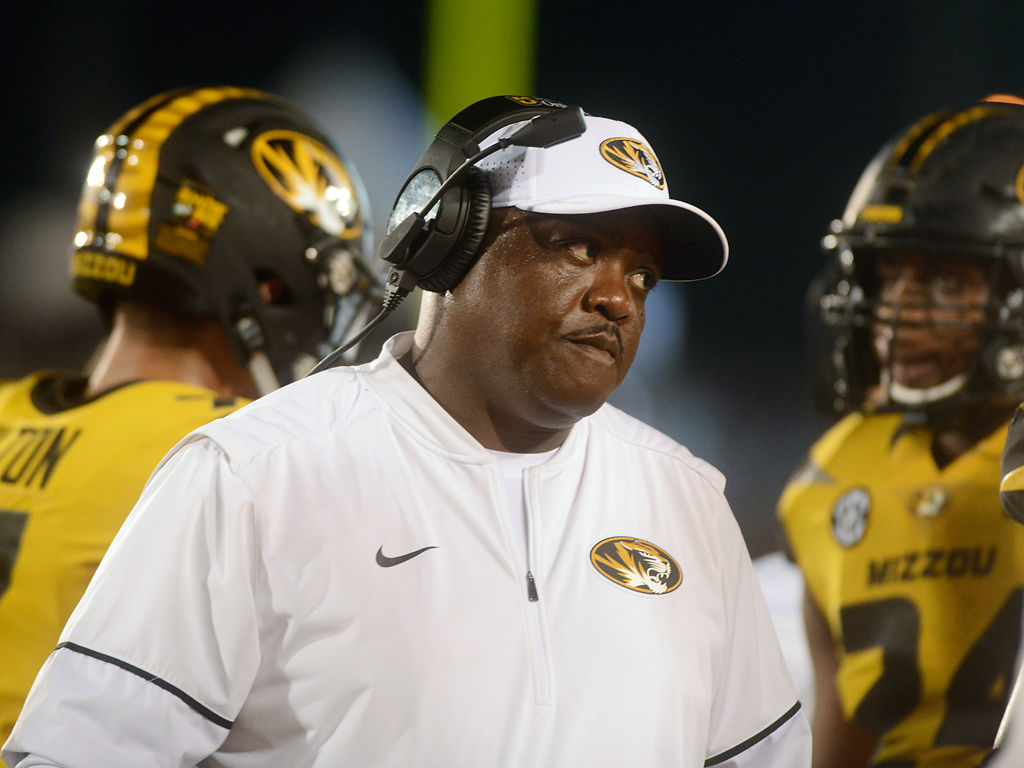forced to resign resignation letter%0A Missouri defensive line coach Brick Haley glares