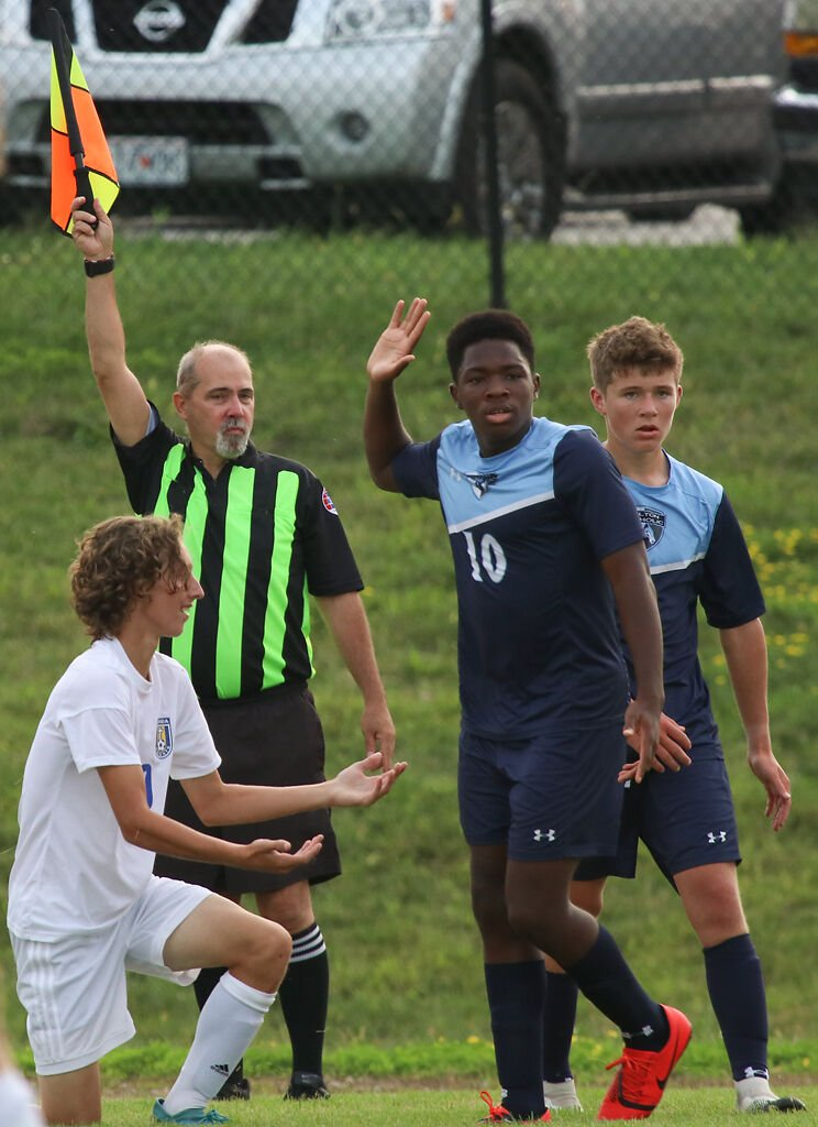 Tolton's Joel Eboreime puts his hand in the air after committing a foul