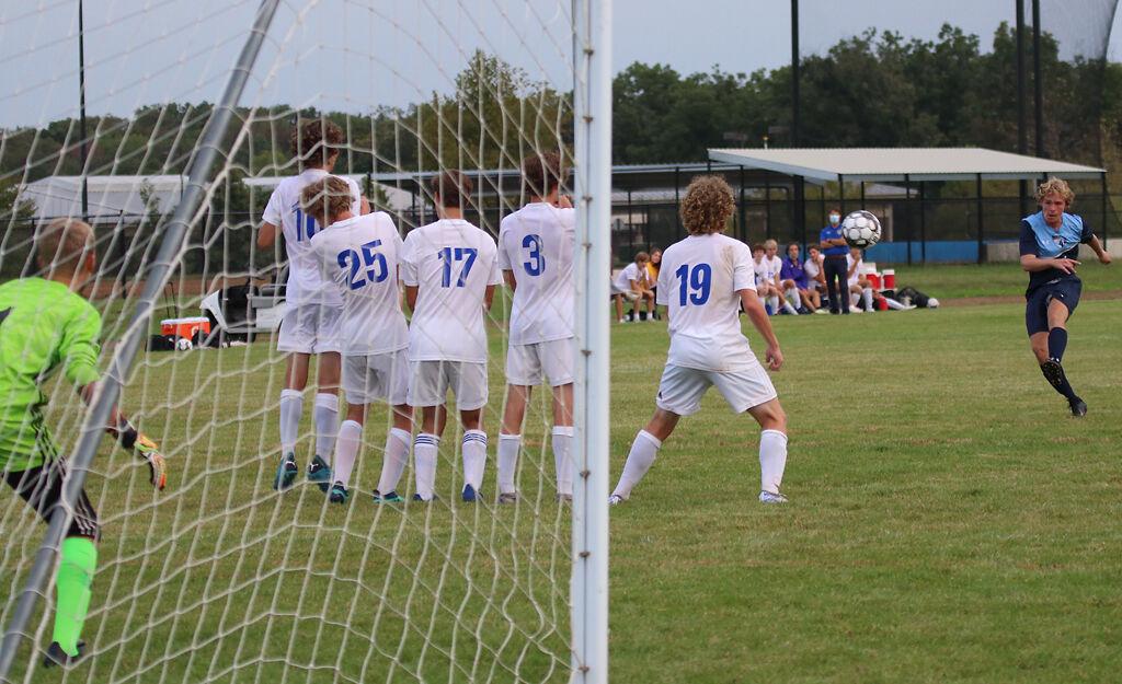 Tolton Catholic High School forward Landon Petri sends a free kick