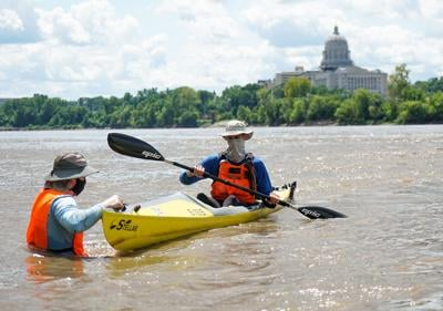 A solo paddler reaches the Jefferson City checkpoint