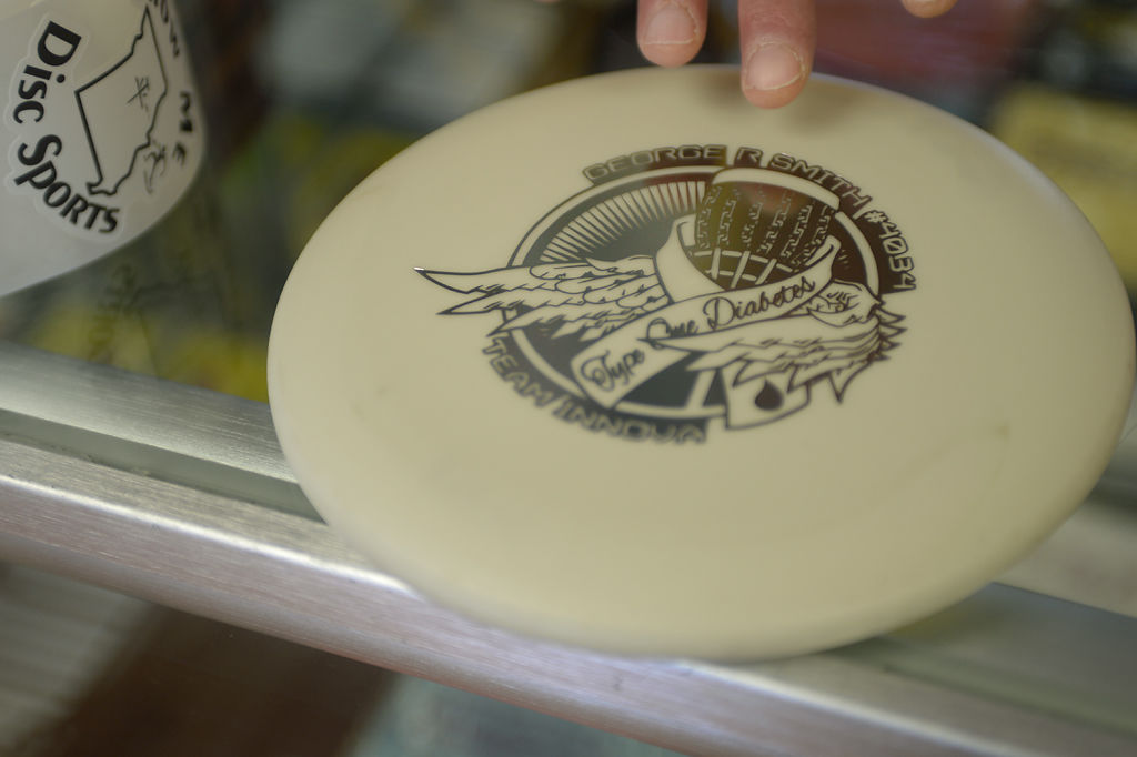George Smith shows a disc he helped create