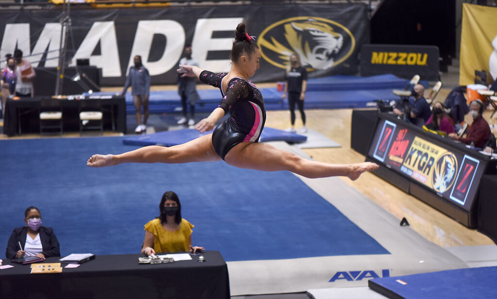 Missouri's Sydney Schaffer leaps on the beam
