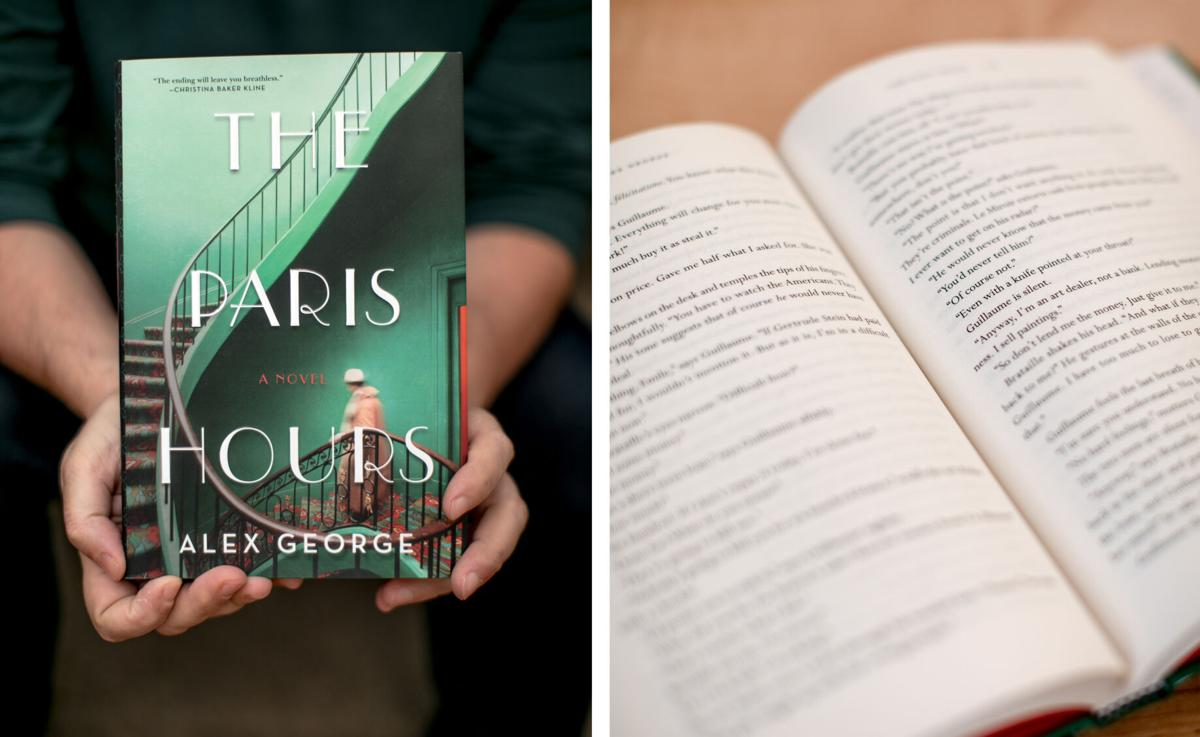 """Alex George holds his new novel called """"The Paris Hours"""" on Sept. 6 in Skylark Books in downtown"""