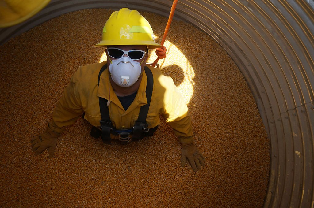 A member of the University of Missouri Fire and Rescue Training Institute stands in a simulated grain elevator