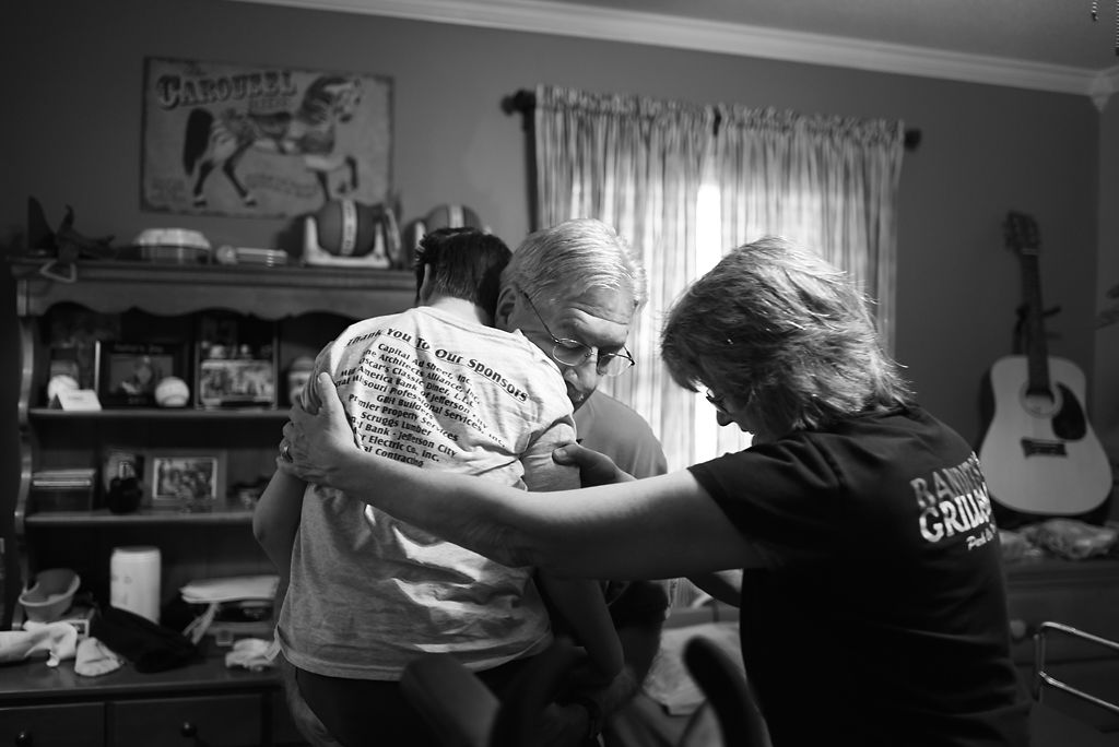 Eleven-year-old Taylor Surprenant is awakened by his grandparents, Randy and Johnna Carrender