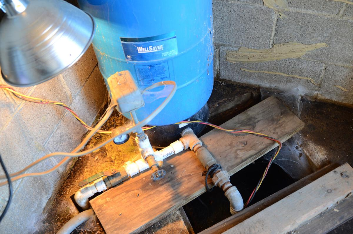 Two groundwater pumps sit behind Doug Doughty's home