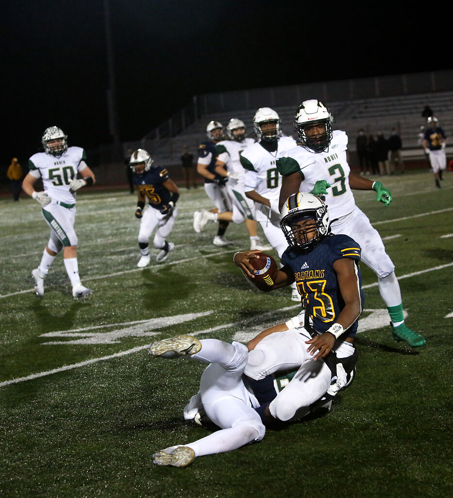 Battle senior Khaleel Dampier is tackled after carrying the ball past the line of scrimmage by Fort Zumwalt North junior Chris Reckel during the Class 5 state quarterfinal game