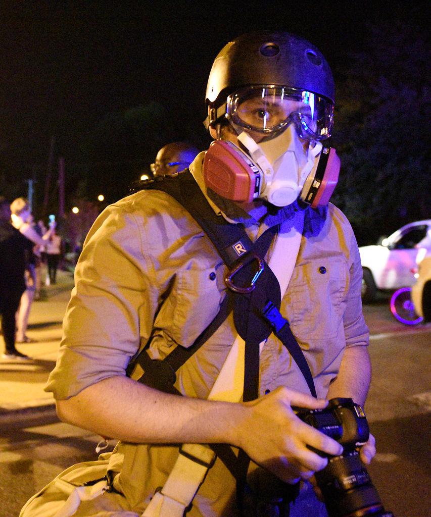 Missourian photo editor Davis Winborne watches riot police line up