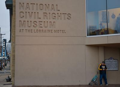 A Missouri fan waits outside the National Civil Rights Museum
