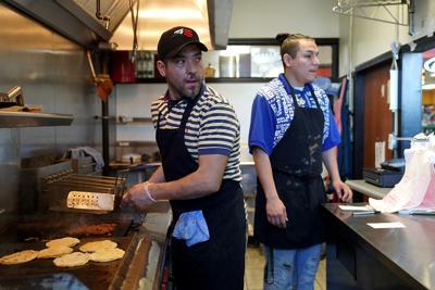 """Francisco """"Pancho"""" Rutiaga and his son, Francisco Rutiaga, handle the lunch rush"""