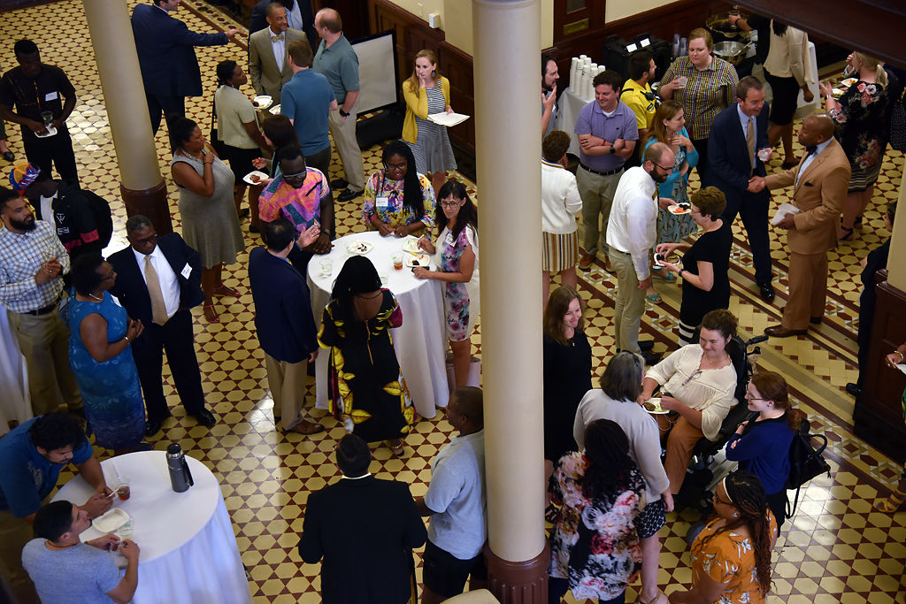 Friends, family and faculty mingle before a farewell reception