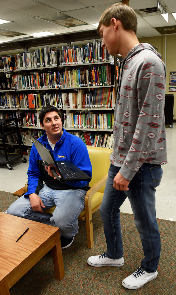 Matt Baker hands Jacob Crede back his laptop