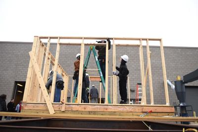 Battle High School sophomores hammer the walls of the house they're constructing in their geometry and construction class