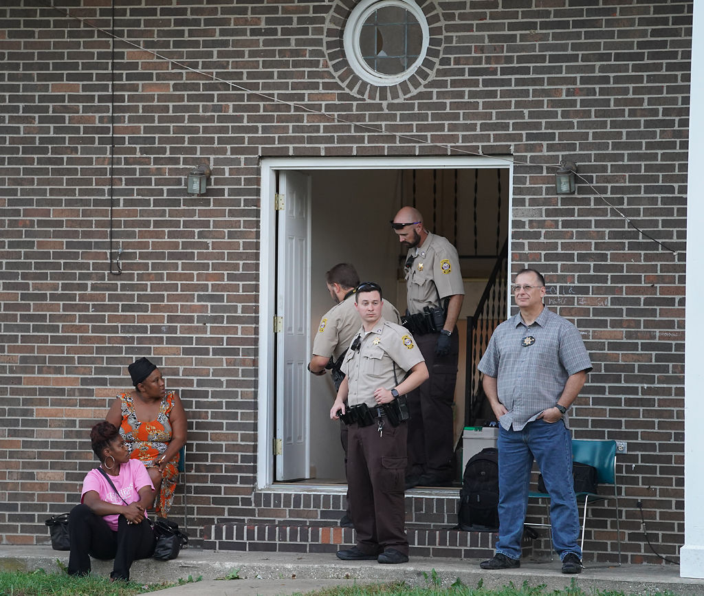 Boone County Sheriff deputies talk to Maleshia Estes, left, and Mary Sanders