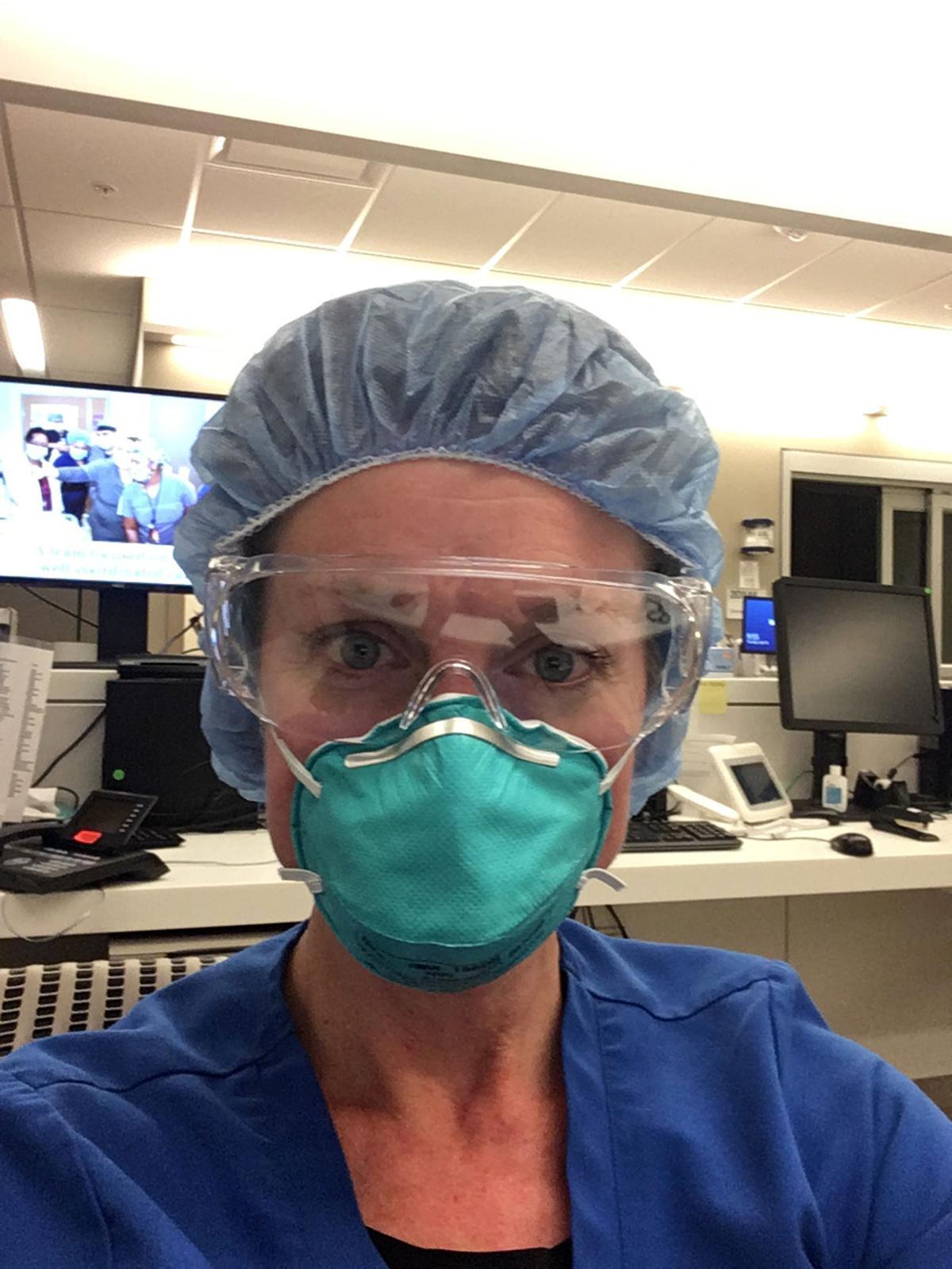 Susan Scott wears her personal protective equipment