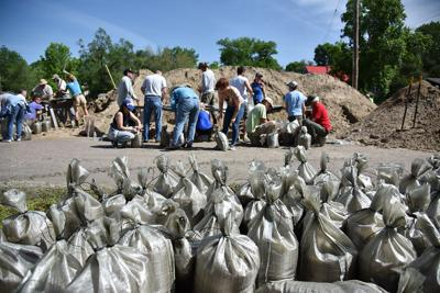 Volunteers rush to keep Missouri river towns dry as more flooding looms