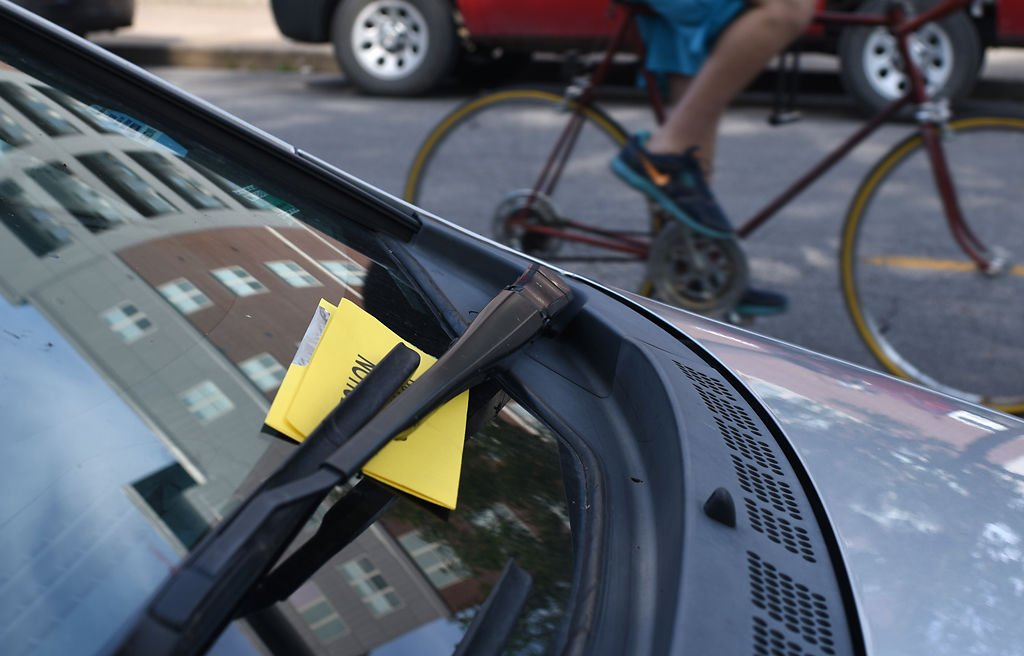 Parking downtown still causes strife even with new technology a parking ticket is tucked between the windshield wipers of a parked car solutioingenieria Gallery