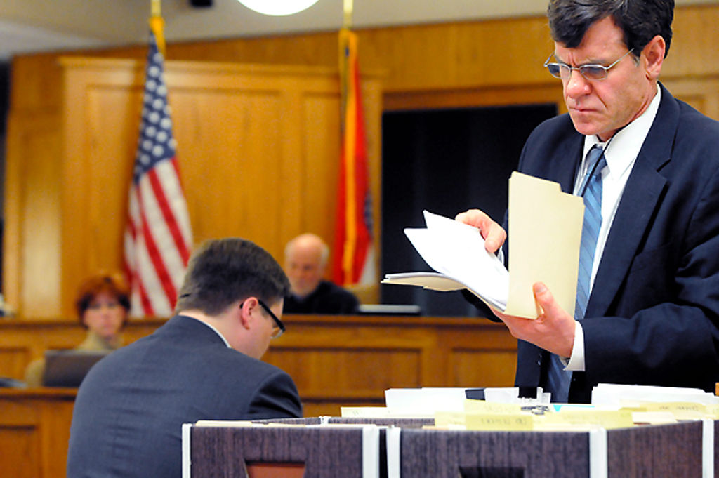 Boone County Prosecuting Attorney Dan Knight rifles through evidence