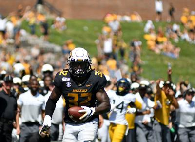 Missouri linebacker Nick Bolton sprints toward the end zone during the game against West Virginia