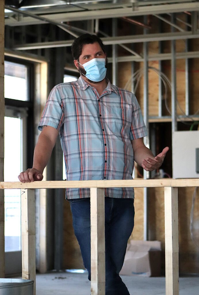 Bryan Maness, owner of the up-and-coming Ozark Mountain Biscuit Co. restaurant, talks about the construction plans on Friday in Columbia.