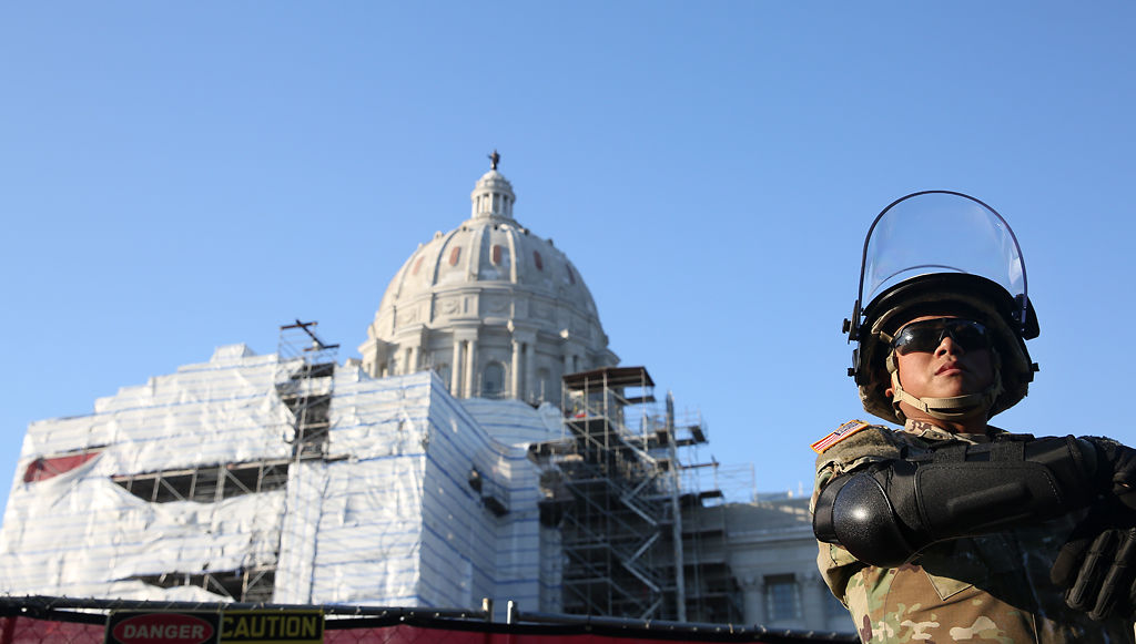 A member of the National Guard stands in front of the Capitol Building in Jefferson City