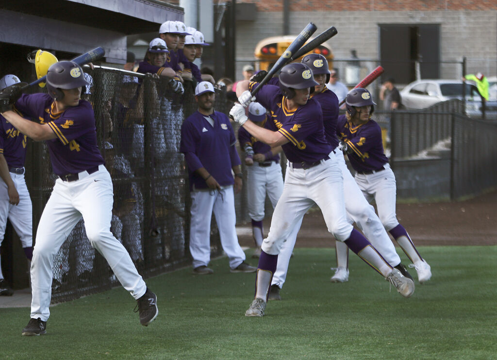 Hickman High School's baseball team warms up