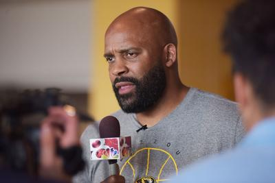 Cuonzo Martin talks to reporters