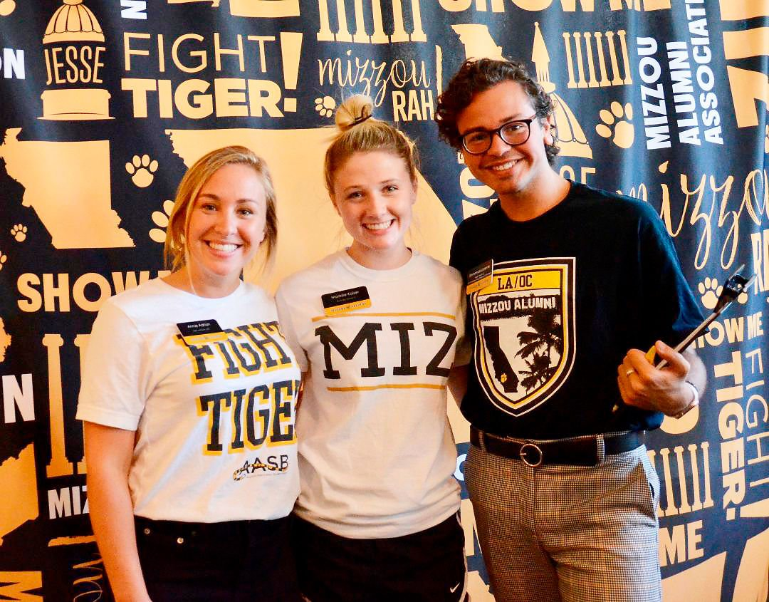 Annie Adrian, Maddie Kaiser, and Emmanuel Llorente pose for a photo at the MU Summer Welcome Fair