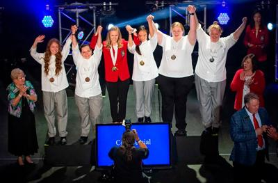 Rachel Riegel, far left, takes a photograph with other award winners at the  SkillsUSA Championship