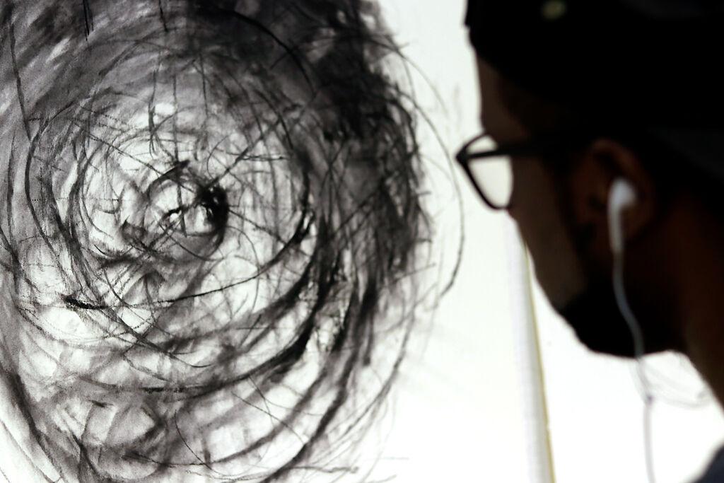 Askia Bilal works on a piece
