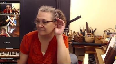 Margaret Waddell teaches her pupils to play piano via Zoom