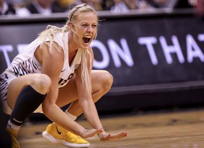 Sophie Cunningham cheers on her team as Missouri scores against Auburn in 2019