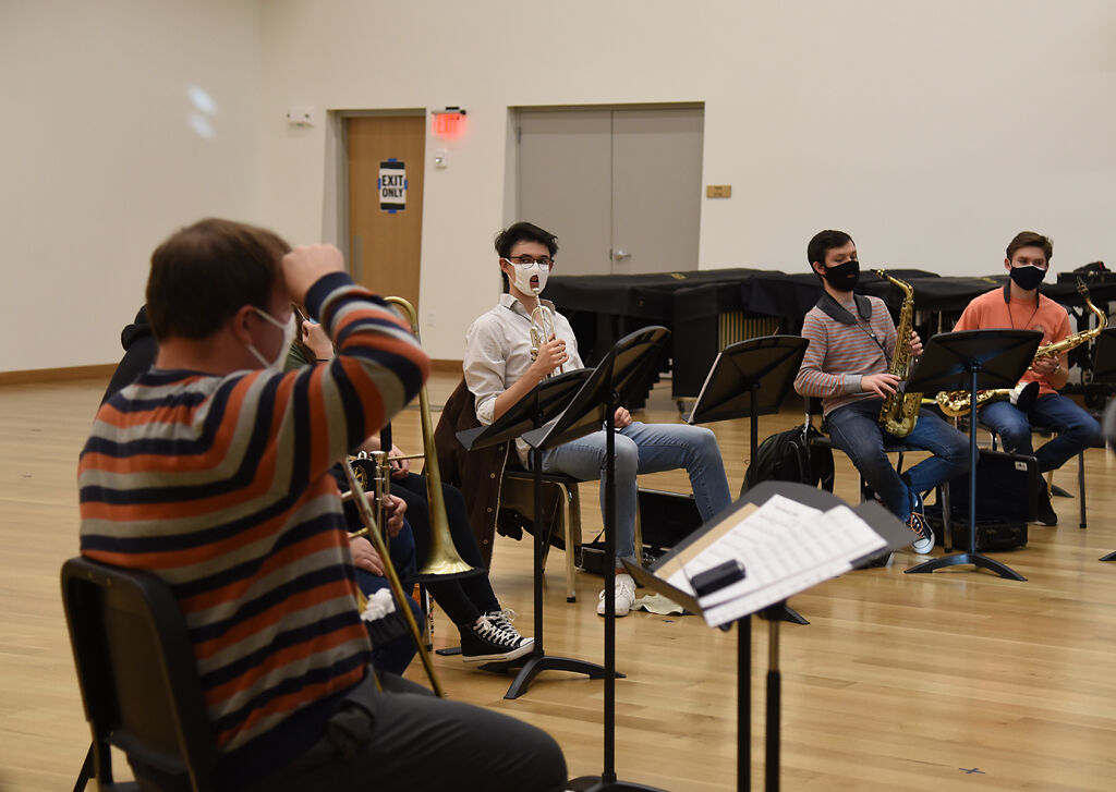 Assistant teaching professor Sam Griffith, left, instructs the jazz band at the Sinquefield Music Center