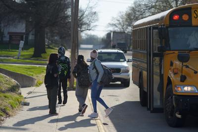 Students disembark the morning bus (copy)