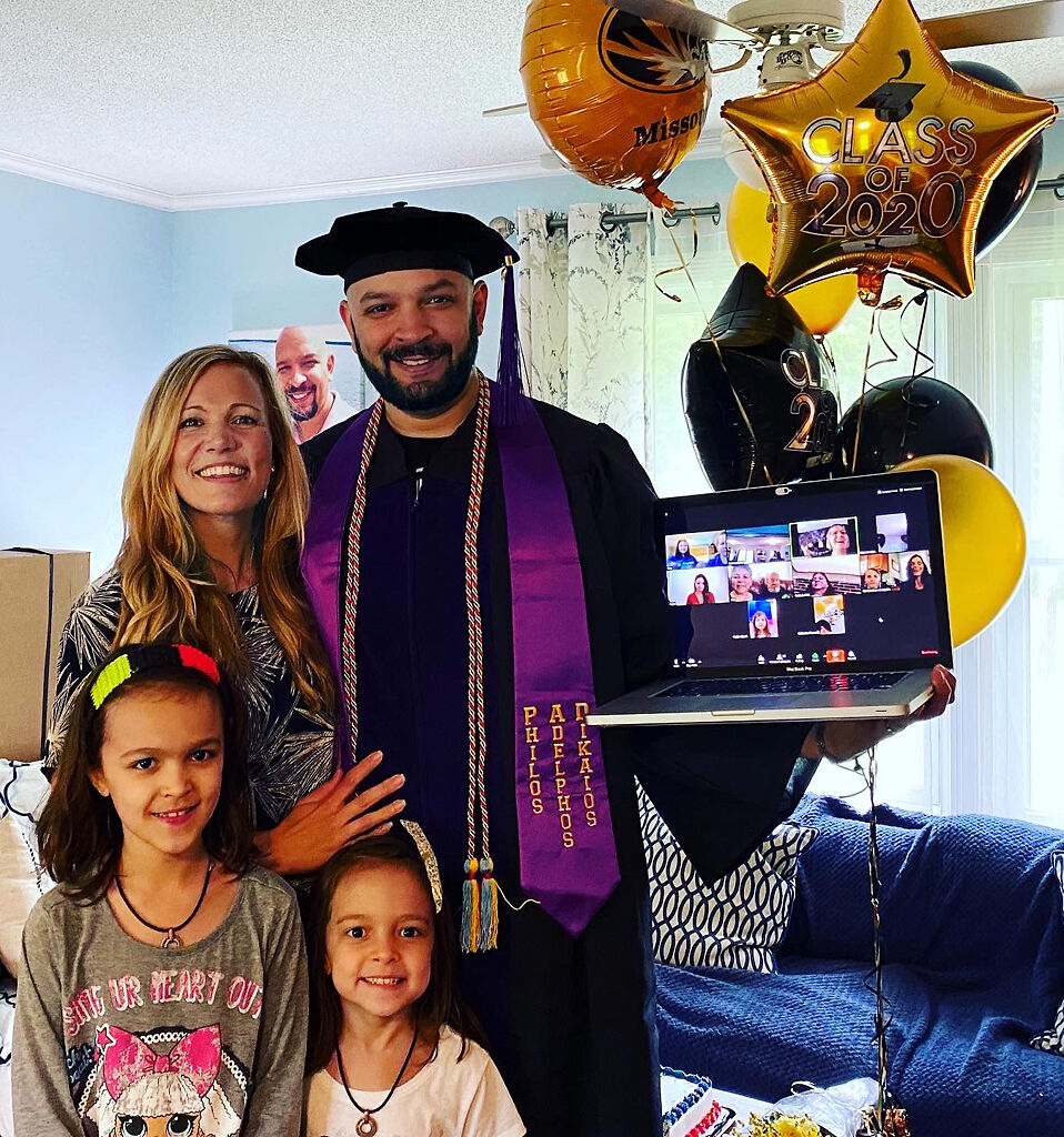 University of Missouri School of Law graduate Don Quinn celebrates his graduation with family over Zoom