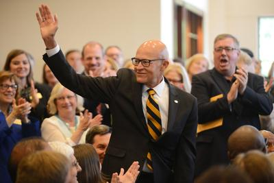 Former interim UM System President Mike Middleton waves to the crowd (copy)
