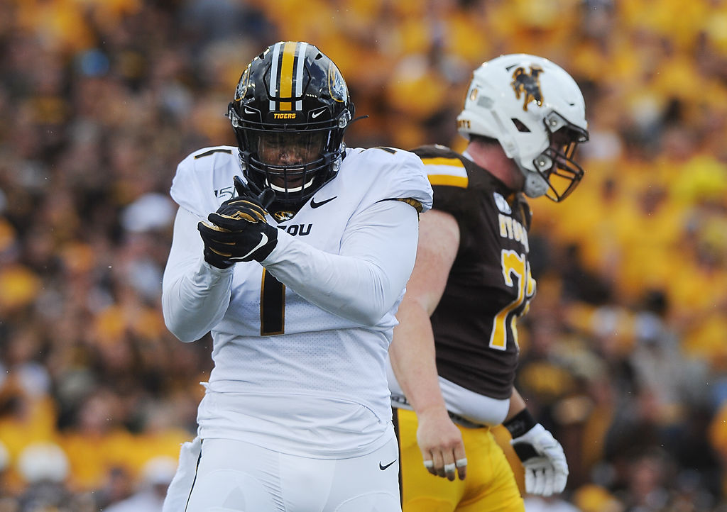 Tyler Badie celebrates after a play