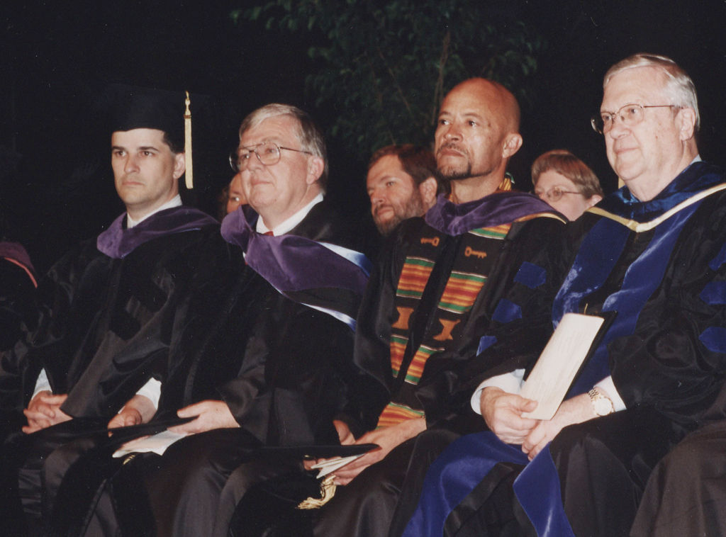 Mike Middleton sits with faculty and staff