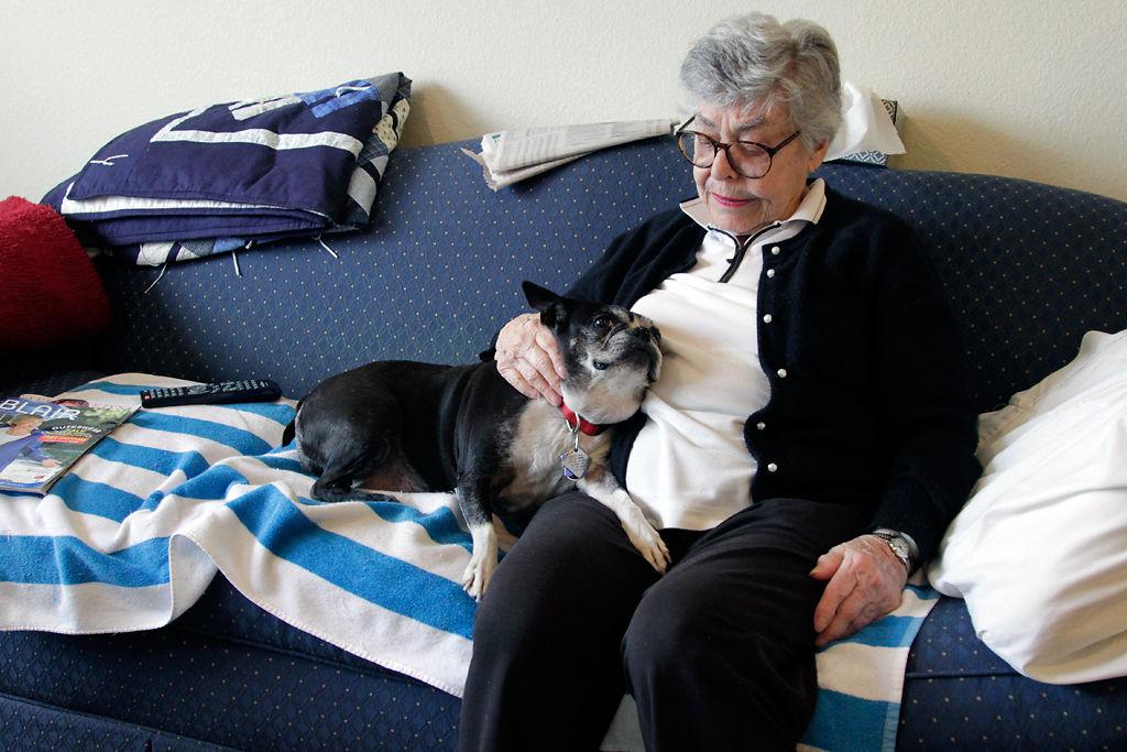 Elizabeth Kennedy pets her dog