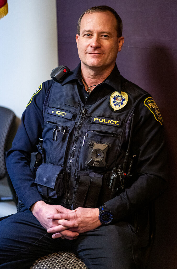 Officer Dan Wright sits for a portrait