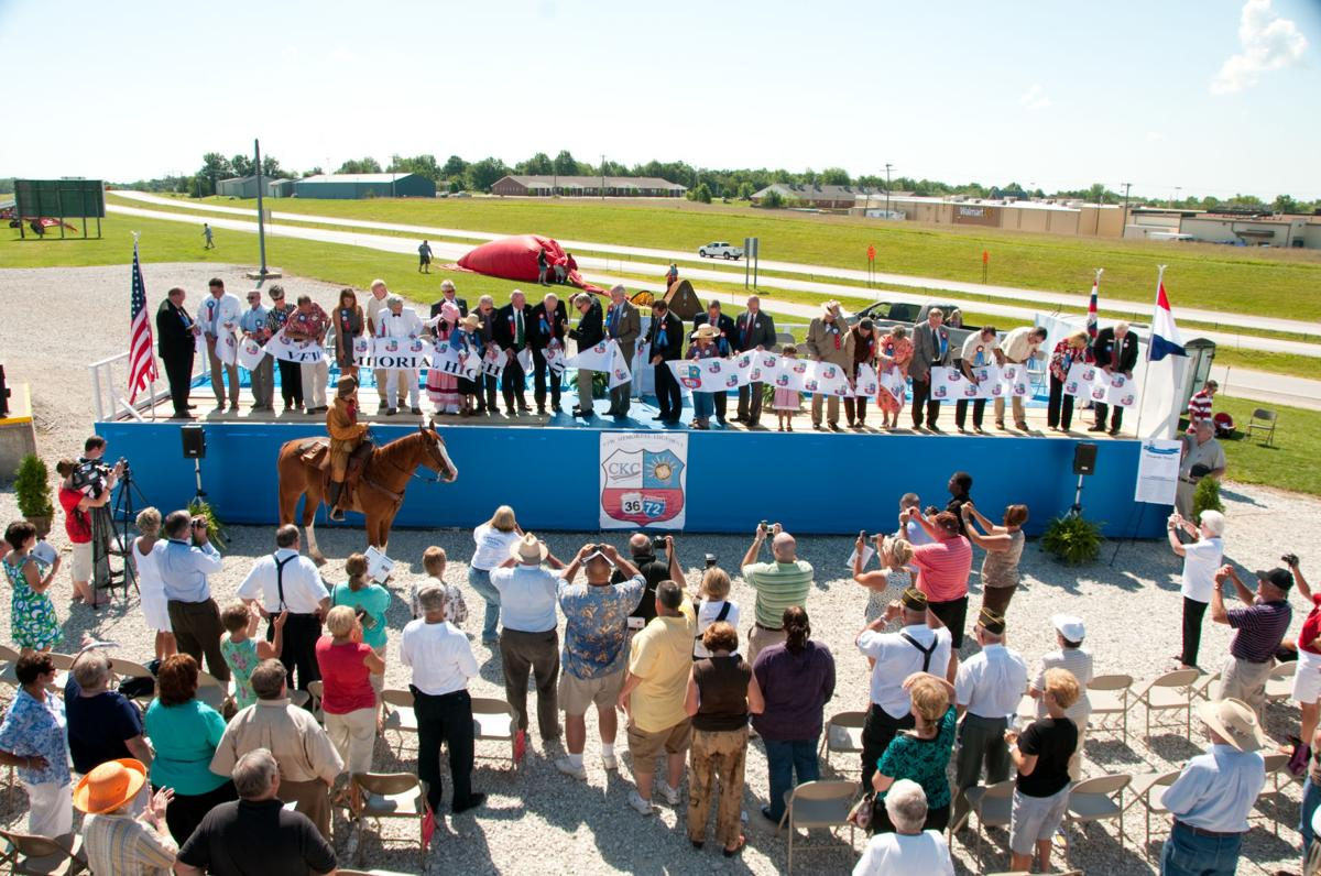 A crowd gathers to watch the re-opening of U.S. 36