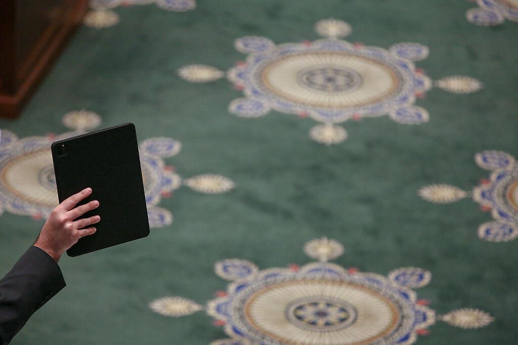 Sen. Greg Razer, D-Kansas City, holds a tablet